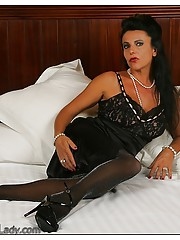 video of young girls with legs crossed wearing nylons and heels
